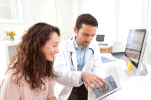 Doctor-patient-reviewing-electronic health records