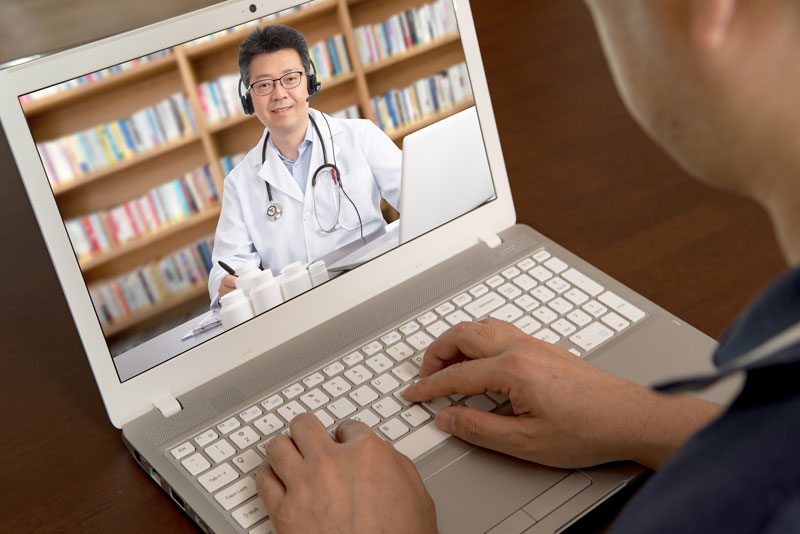 telehealth-and-physician-remotely-consulting-with-a-patient
